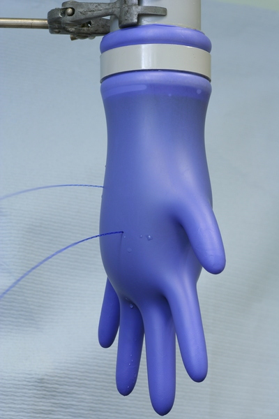 picture of a leaking glove - BS EN 455 Part 1